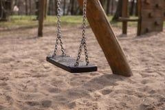 Empty swing on children playground Stock Image