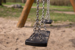 Empty swing on children playground Royalty Free Stock Photography