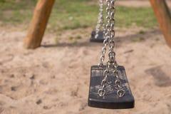 Empty swing on children playground Stock Photography