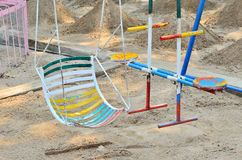 Empty swing on children playground. Royalty Free Stock Photography