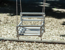 Empty swing on children playground. In city Stock Images