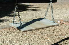 Empty swing on children playground. In city royalty free stock images