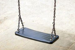 Empty swing on children playground in city. Stock Images