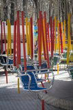 Empty swing on children playground Stock Images
