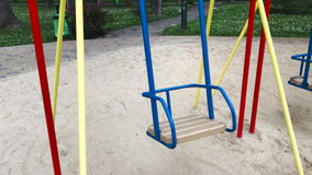 An empty swing moves stock video footage