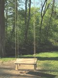 Empty swing in the park - mysterious scenery royalty free stock photos