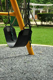 Empty swing in a play ground Stock Image