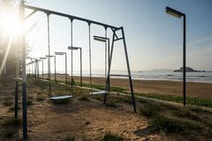 Empty swing at the playground on the beach of Weligama. Sri Lanka Royalty Free Stock Photos