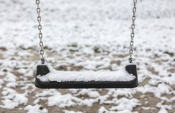Empty swing in playground Royalty Free Stock Images