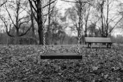 Empty swing on playground Royalty Free Stock Images