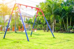 Empty swing in the playground. For children funny day from outdoor Stock Photography