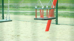 Empty swing on playground. Stock Photo