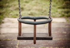Empty swing in the playground Stock Image