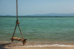 Empty Swing on sea Royalty Free Stock Image