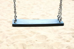 Empty swing set on playground. Empty swing set seesaw on playground royalty free stock photo