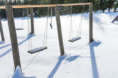 Empty swing with snow in winter Stock Photography