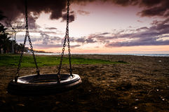 Empty Swing On Sunset In Public Park Royalty Free Stock Photography