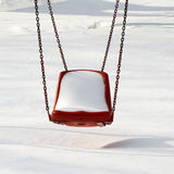 Empty swing in winter time Stock Photography