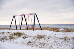 Empty swings Stock Images