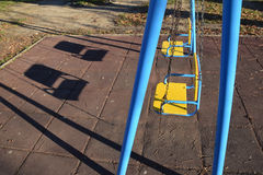 The  empty swings for children in the park Royalty Free Stock Photography