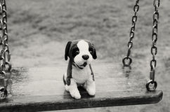 Empty swings. The Lost Child. Black and white image. stock image