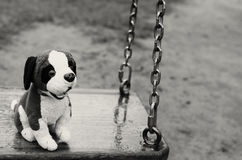 Empty swings. The Lost Child. Black and white image. stock images