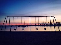 Empty swings at San Diego Stock Photography