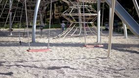 Empty swings at playground stock video footage