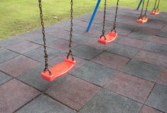 Empty swings on playground Royalty Free Stock Image