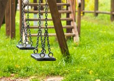 Empty swings at playground for child Royalty Free Stock Photo