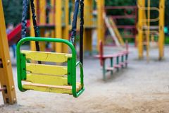 Empty swings on the playground. Remind of childhood memories Stock Image