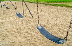 Empty swings in playground Royalty Free Stock Photo