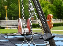 Empty swings in a playground stock images