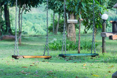 Empty swings on playground Royalty Free Stock Photos