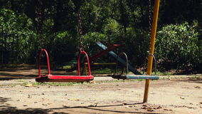 Empty Swings Swaying At Playground stock video footage