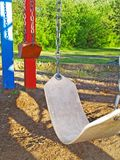 Empty Swingset. A swingset swaying in the breeze Royalty Free Stock Photography