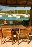Empty table in beach restaurant on lagoon. Of Hvar, Croatia Stock Photography
