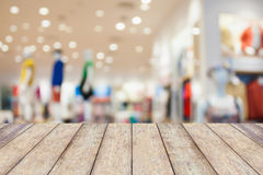 Empty table and blur clothing store Royalty Free Stock Photo