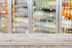 Empty table with blur supermarket refrigerator Stock Photo