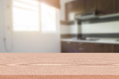 Empty table and blurred kitchen background, product montage display.  Stock Photo