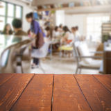 Empty table and blurred people in cafe, product displ Royalty Free Stock Image