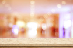 Empty table and blurred store bokeh background Royalty Free Stock Images