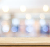 Empty table and blurred store bokeh background Royalty Free Stock Photo