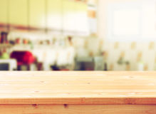 Empty table board and defocused retro kitchen background.