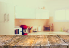 Empty table board and defocused white retro kitchen background.  Royalty Free Stock Images