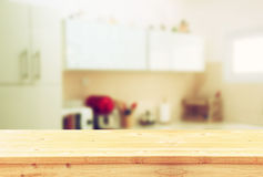 Empty table board and defocused white retro kitchen background.