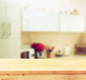 Empty table board and defocused white retro kitchen background Royalty Free Stock Image