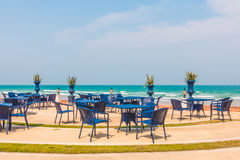 Empty table and chair around beach background Royalty Free Stock Images