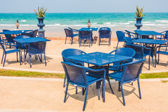 Empty table and chair around beach background Royalty Free Stock Photography