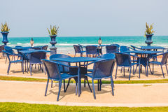Empty table and chair around beach background Stock Photography